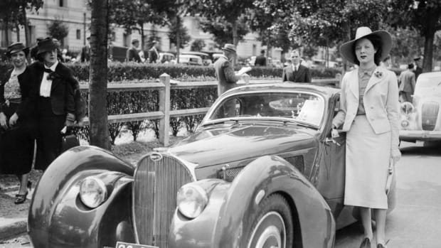 In 1937, Andre Bith had the Bugatti Type 51 Grand Prix chassis once raced by famous driver Louis Chiron fitted by Louis Dubos with a Bugatti Atlantic-type body. The car then appeared on rallys and the concours circuit. It is pictured here with Miss Lucette Joussy at a concours at Bois de Boulogne, France, in June 1938.