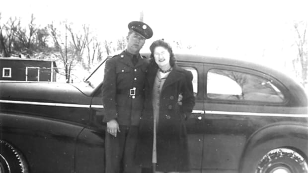 Ray and Mildred Lambrecht pose in front of their 1946 Chevrolet.
