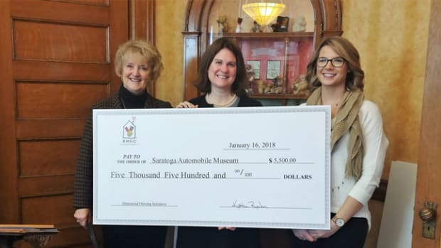 RMHC Vice President for Grants Kathie Reeher, Saratoga Automobile Museum Executive Director Carly Connors, and RMHC's Meaghan Pinkowski at the Ronald McDonald House in Albany on Jan. 16, 2018 (photo credit: Relentless)