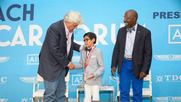 Jay Leno invites a young automotive enthusiast to join him and Donald Osborne on stage at the conclusion of their 2017 Pebble Beach Classic Car Forum.