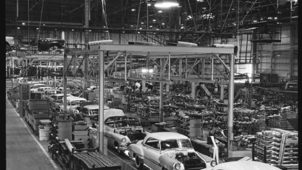 "1952 Oldsmobile, Pontiac and Buick two-door hardtops move down the Fairfax plant's ""final line."""
