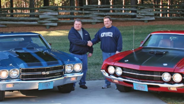 """LS-6 Chevelle SS454 owner Dennis Clegg (left) shakes hands with Torino Cobra owner Larry Jensen (right) before their cars """"faced off"""" on the 2013 Iola Old Car Show poster."""