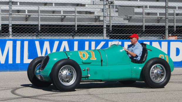 "William Miller of Frankfort, Ind., takes to the track in his vintage Indy racer during the Harry A. Miller Club's ""Millers at Milwaukee"" meet on July 12-13 in Milwaukee, Wis."