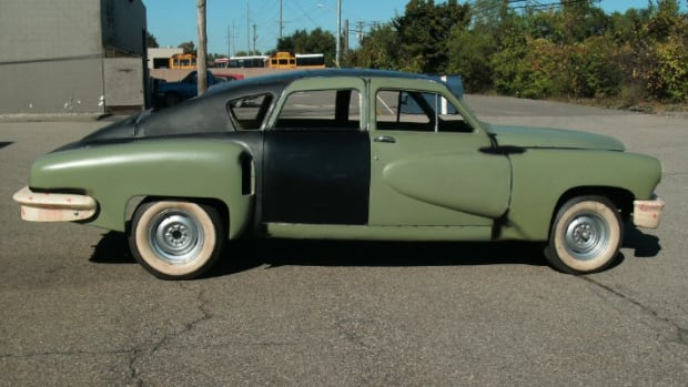 Never-used and used 1948 Tucker parts are being assembled to the cowl of what was to be Tucker 1052, thus creating a new Tucker with almost all Preston parts.