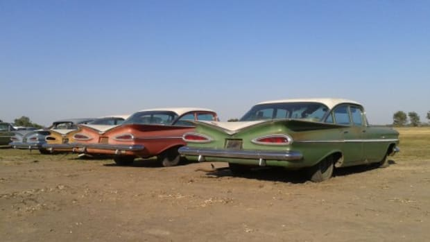 A line of unsold 1959 Chevrolet four-doors and one lone two-door Bel Air traded in to Ray Lambrecht of Lambrecht Chevrolet Co. The 1959 Bel Air two-door sedan is already being flipped by a Nebraska car dealer.