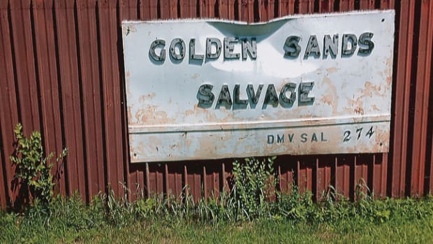 The Golden Sands Salvage sign attached to the beauty fence fronting Airport Road in Boscobel, Wis.