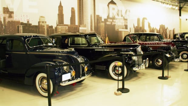 A wall-spanning city skyline mural provides the setting for a display of 1930s and '40s luxury cars donated by the Taulborg family to the Classic Car Collection. Photo: John Lee