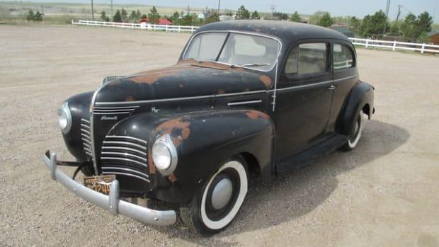 Auction Lot 13: 1939 Plymouth barn fresh estate cars from the John Geisler estate.