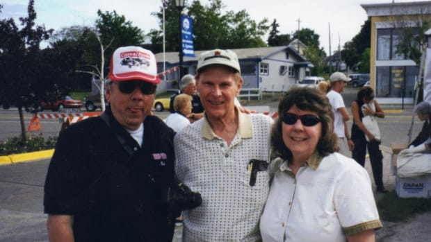 Bob Stevens (left) and his sister Carol (right) had a good time talking to Ford historian David Lewis at the St. Ignace car show in June 2002.