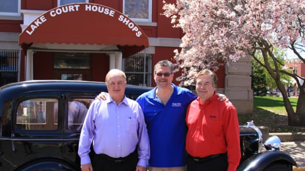 Sen. Rick Niemeyer, left, stands with Speros A. Batistatos, president and CEO of the South Shore CVA, and Roger Pace, the new owner of the 1933 Essex Terraplane 8, after the car's auction on Saturday, May 2, in front of the Crown Point Courthouse.