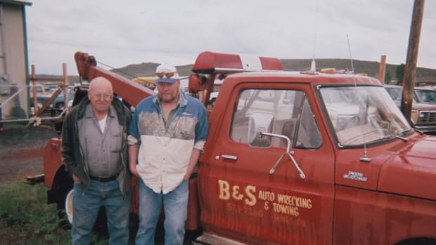 Father and son (l-to-r) Larry and Gary Foster pose with one of their salvage yard¹s wreckers. Their yard, B&S Auto Wrecking & Towing, is located in Hines, Ore., and specializes in light- and medium-duty trucks.
