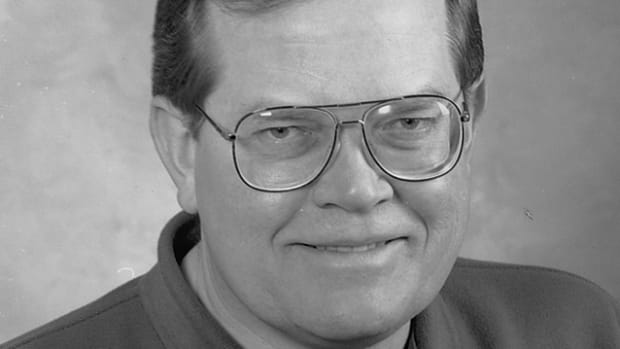 A 1996 staff photo of James T. Lenzke.