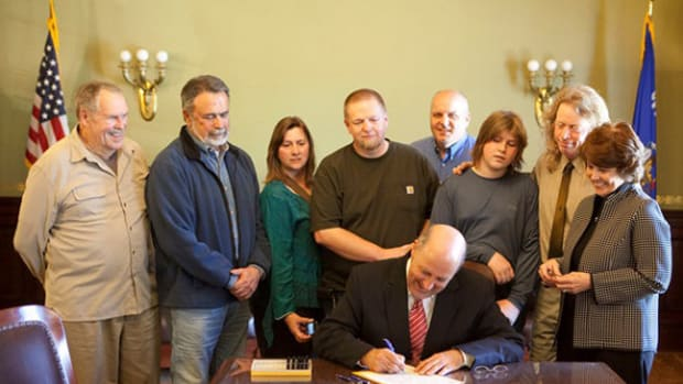 Wisconsin Governor Jim Doyle signing Act 225 in 2009 as a result of efforts by SEMA Action Network (SAN) member Paul Underwood and his group. Pictured left to right: Chet Underwood, George Stauffer (owner of Stauffer Classics, LTD), Sioux Underwood, Thomas Landmann, Governor Doyle, Tryge Knutson (Senator Erpenbach's staff), Ullr Underwood, Paul Underwood and Rep. Sondy Pope-Roberts.