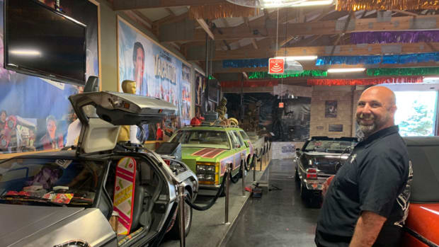 "The family truckster from ""National Lampoon's Vacation"" is seen in the background as Volo Auto Museum Director Brian Grams talks about new exhibit installations and other work under way at the Volo Auto Museum while it is closed. The Grams family has elected not to reopen the museum under current Phase 4 restrictions."