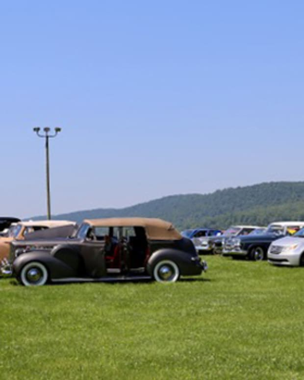 Parked cars at the Ruritan grounds, awaiting the start of the tour.