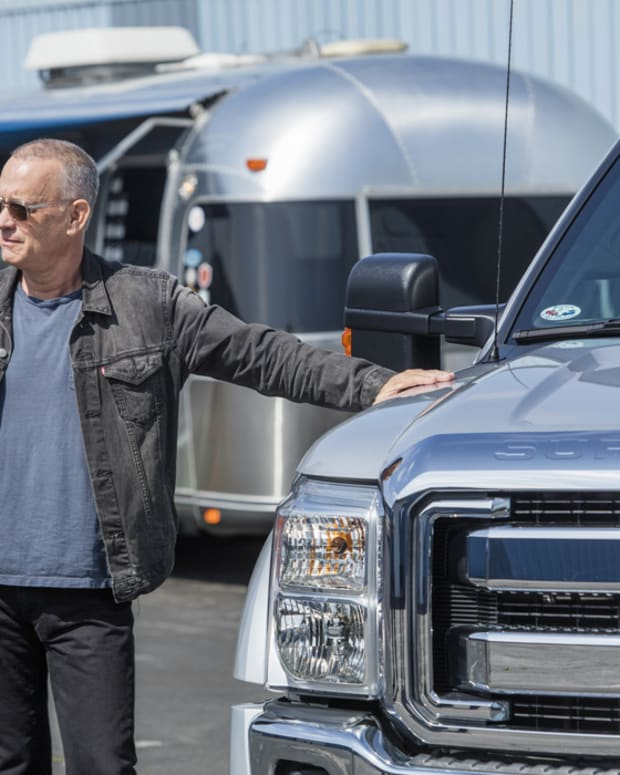 Hanks with 2011 Ford F450 Super Duty Crew Cab Lariat Pickup and Airstream in the background
