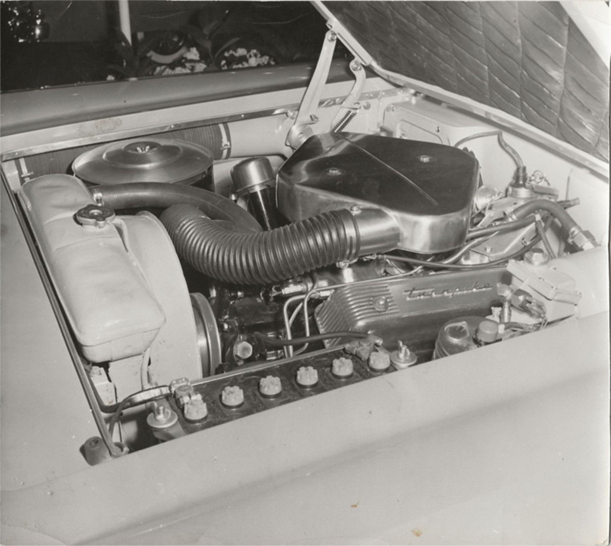 A period image of the original air cleaner and valve covers on the XM-Turnpike Cruiser's dual-carbureted engine. Some of these parts were gone when I bought the car.