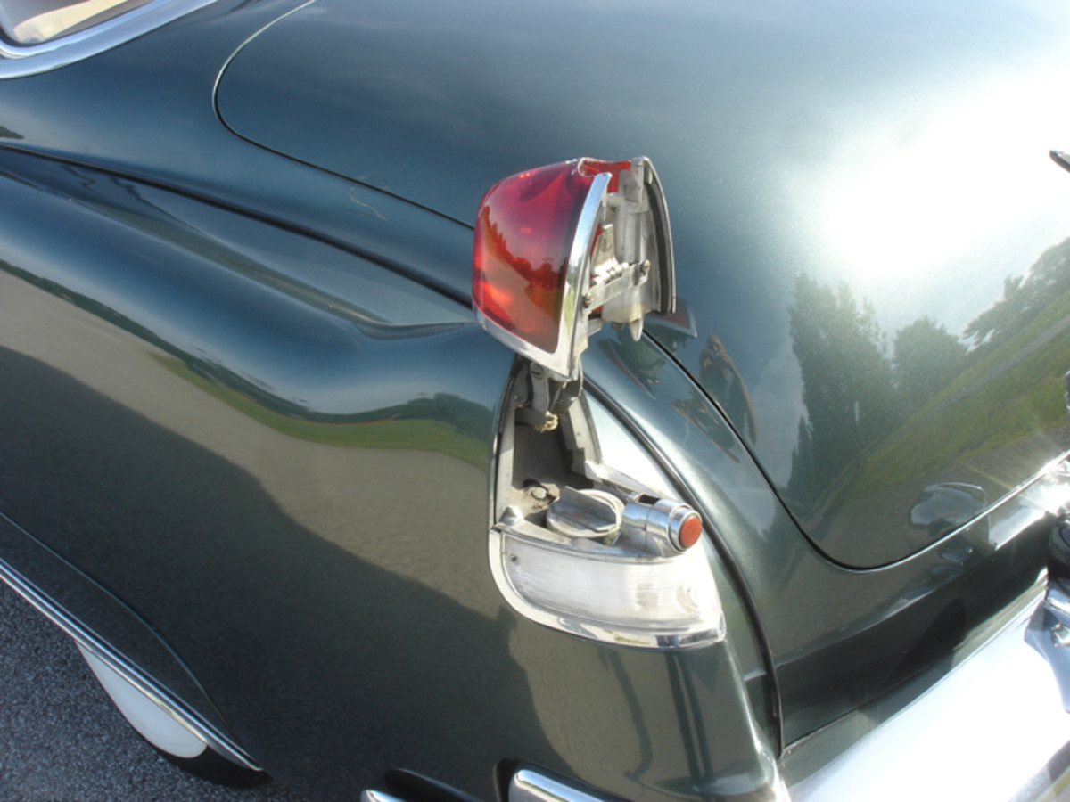 Cadillac famously hid the fuel filler beneath the driver's side taillamp in the 1940s and through much of the 1950s.
