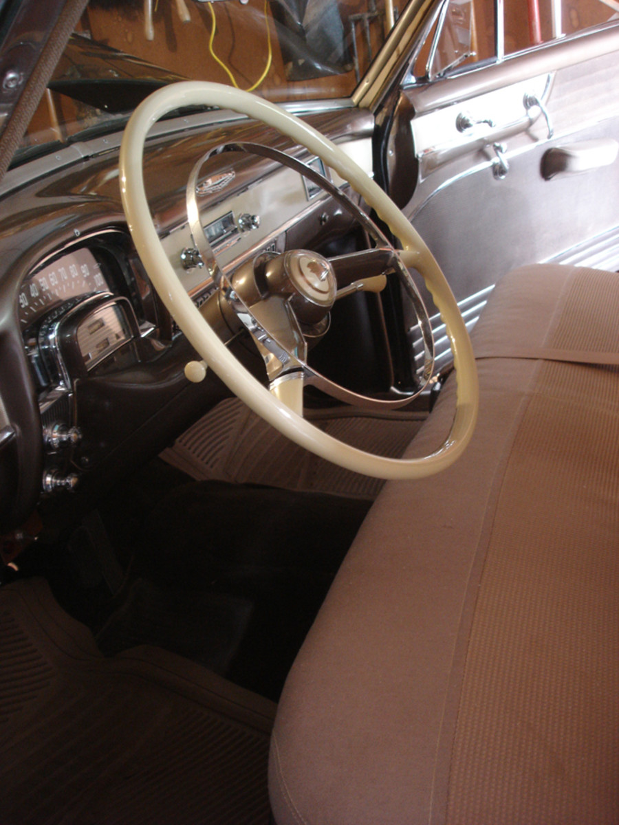 The Cadillac steering wheel had two spokes connected by a horn ring through much of the 1950s.