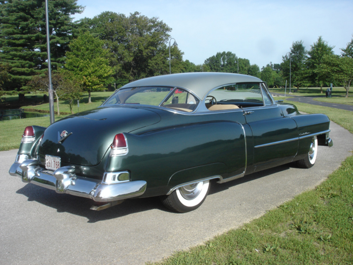 The Series 61 Cadillac was most easily identified in 1950 and '51 by the lack of full-length rocker trim. Also notice the exhaust exits under the bumper in 1951; it would exit through the bumper in '52.