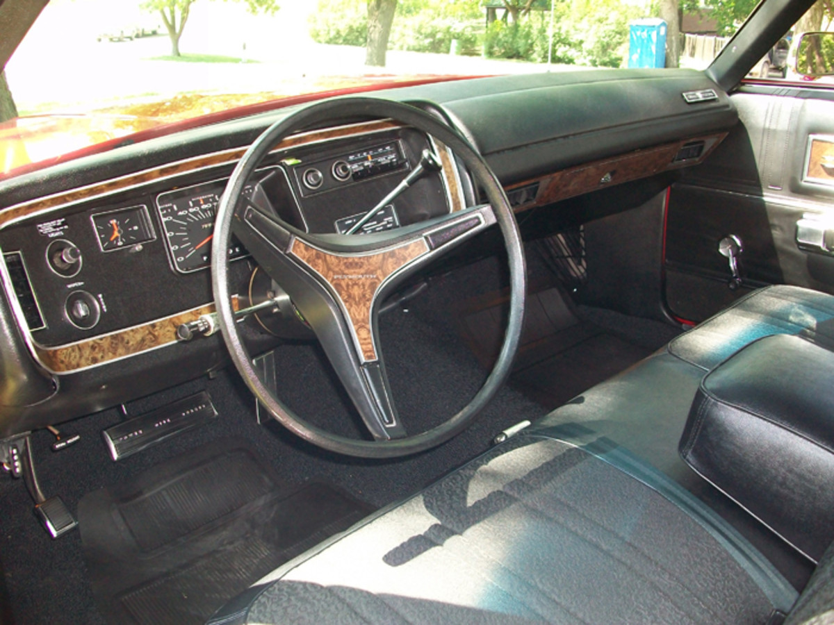 MoPar's wild instrument panels of the early 1960s were replaced by far more simple designs a decade later. By 1972, faux wood accented by silver edging highlighted the sea of black plastic that made up the instrument panel.