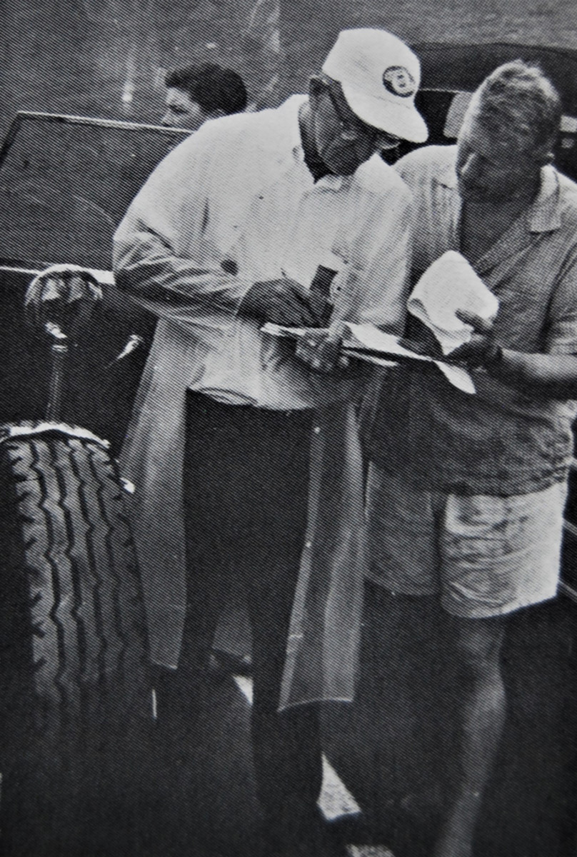 """A.J. """"Jim"""" Hoe in shorts judging at a spring 1963 ACD meet in Auburn, Mass."""