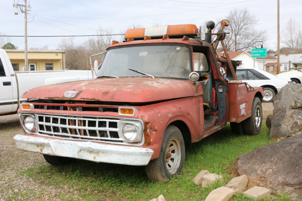 Everything works on this 1965 Ford wrecker, and the missing driver's side door makes it easier to jump in and out. It is still in use, moving inventory around. It is for sale, as are all the vehicles on the premises.