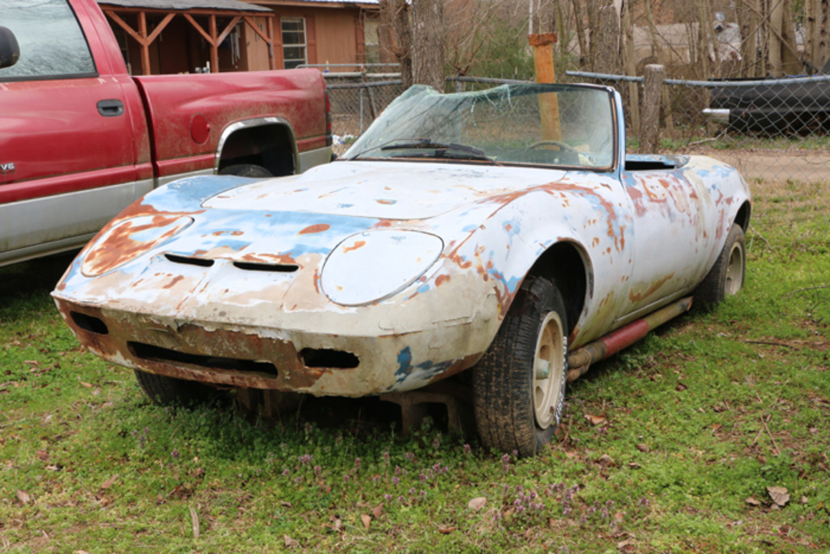 The Opel GT was introduced in 1969 and it resembled a scaled-down Corvette. Someone sliced the top off this GT to make it a roadster and started custom work on the body, including filling in the door handles. Since it's been on the lot, a tree limb fell on the windshield and destroyed it. A skilled ambitious craftsman is needed to finish this one.