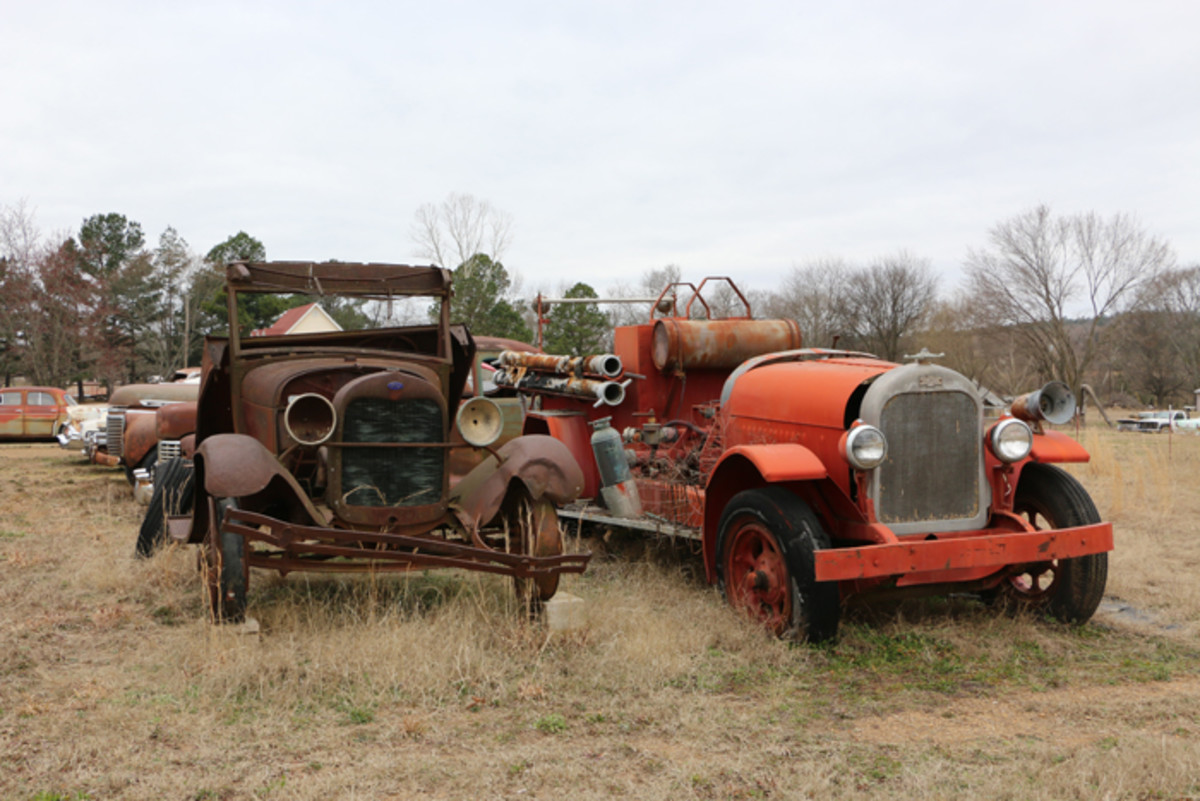 The oldest vehicles on the premises are these two. On the left is a 1928 Ford truck, and on the right is a 1920 American LaFrance fire truck on a Brockway chassis. Varnell says he has everything that goes with the fire truck stored in the shop.