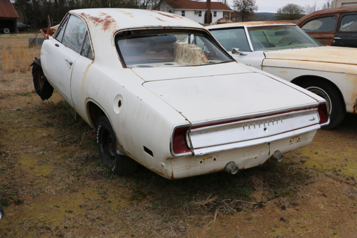 This 1969 Barracuda has its engine and automatic transmission. All the sheet metal from the firewall forward is off of the car, but someone could still build it.