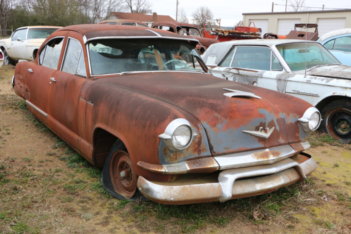This 1953 Kaiser has been parked a long time. It is all there but in rough condition with many broken windows.