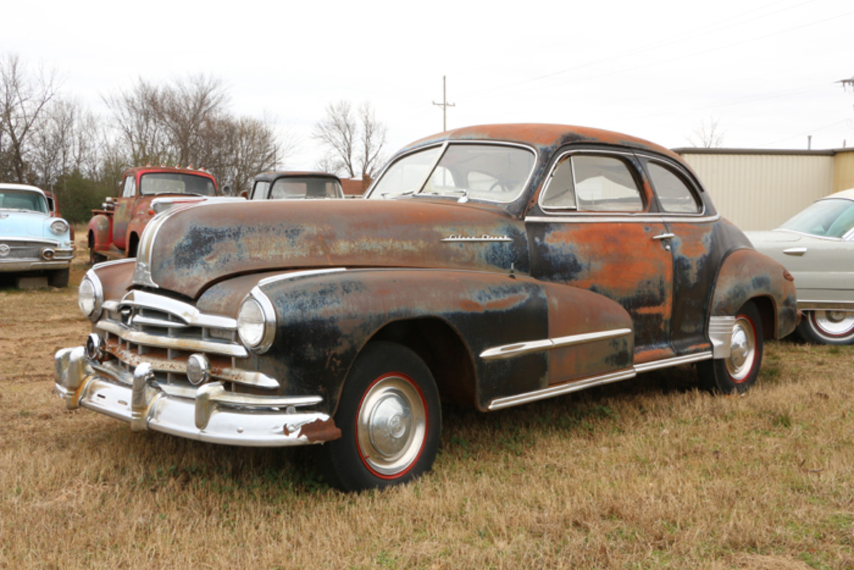 This 1948 Pontiac Silver Streak coupe with a good-looking body has a white vinyl interior that was done years ago. It is stained and deteriorated. The engine and transmission have been removed. This car would make a great cruiser after being restored.