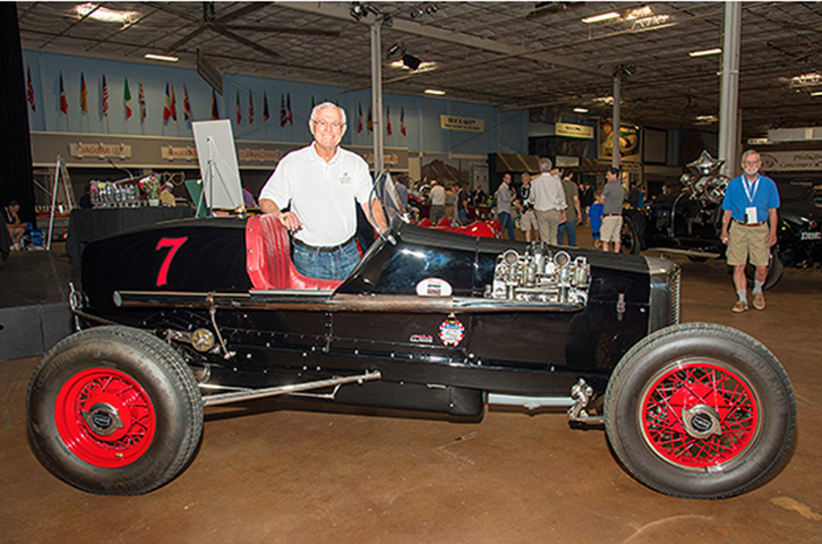 """Dick Vermeil, retired head coach for the NFL's Philadelphia Eagles, St. Louis Rams and Kansas City Chiefs, with his 1926 Ford Miller Schofield Special """"Black Beauty"""" at the Philadelphia Concours d'Elegance, established in 2017."""