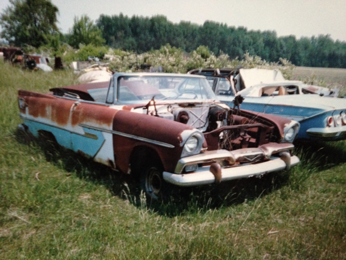 A 1956 Plymouth Belvedere convertible is a rare sight today, and the 1961 Chevy Impala next to it has legions of fans. Either of these rough drop tops would be considered restorable today due to their respective rarity and desirability.
