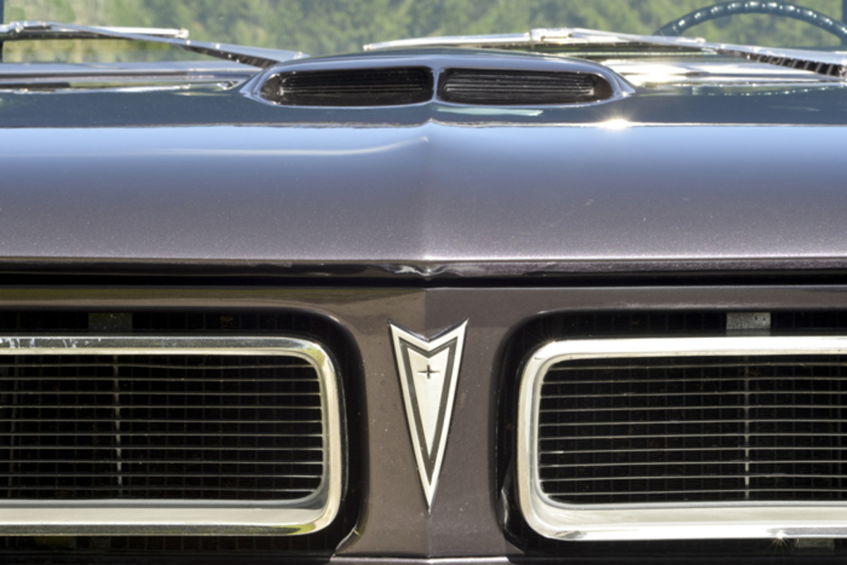 The split grille was already a signature feature of Pontiac in 1965 and would evolve with styling through the division's life.