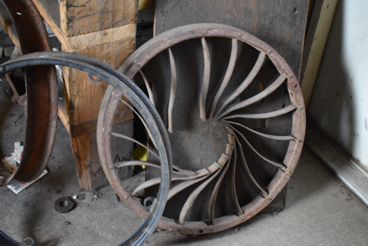 "Scattered around the shops of the Antique Auto Ranch are real treasures such as this period aftermarket ""Spring Wheel,"" a great idea that was poorly executed. It was later deemed a failure."