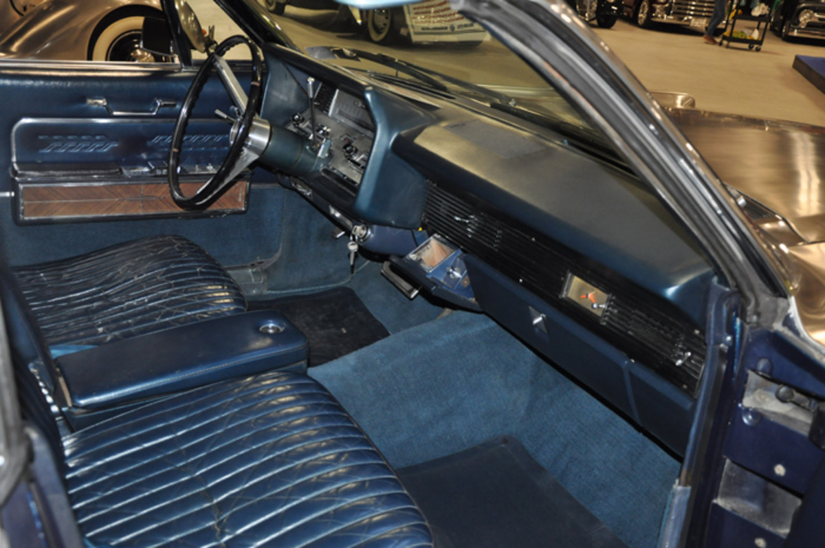 Stainless-steel on the outside, the rich dark blue leather interior of the 1966 Lincoln is in overall very good condition and has been well maintained from new.