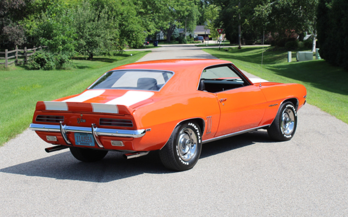 This wonderfully restored 1969 Camaro Z/28 wears Hugger Orange paint with white stripes — as it did originally — and is equipped with the Rally Sport package, which includes the iconic hide-away headlamps. There may have been production muscle cars that were faster in a drag race in '69, but few could stand up to the Z/28 as an all-around performer that could function in the real world.
