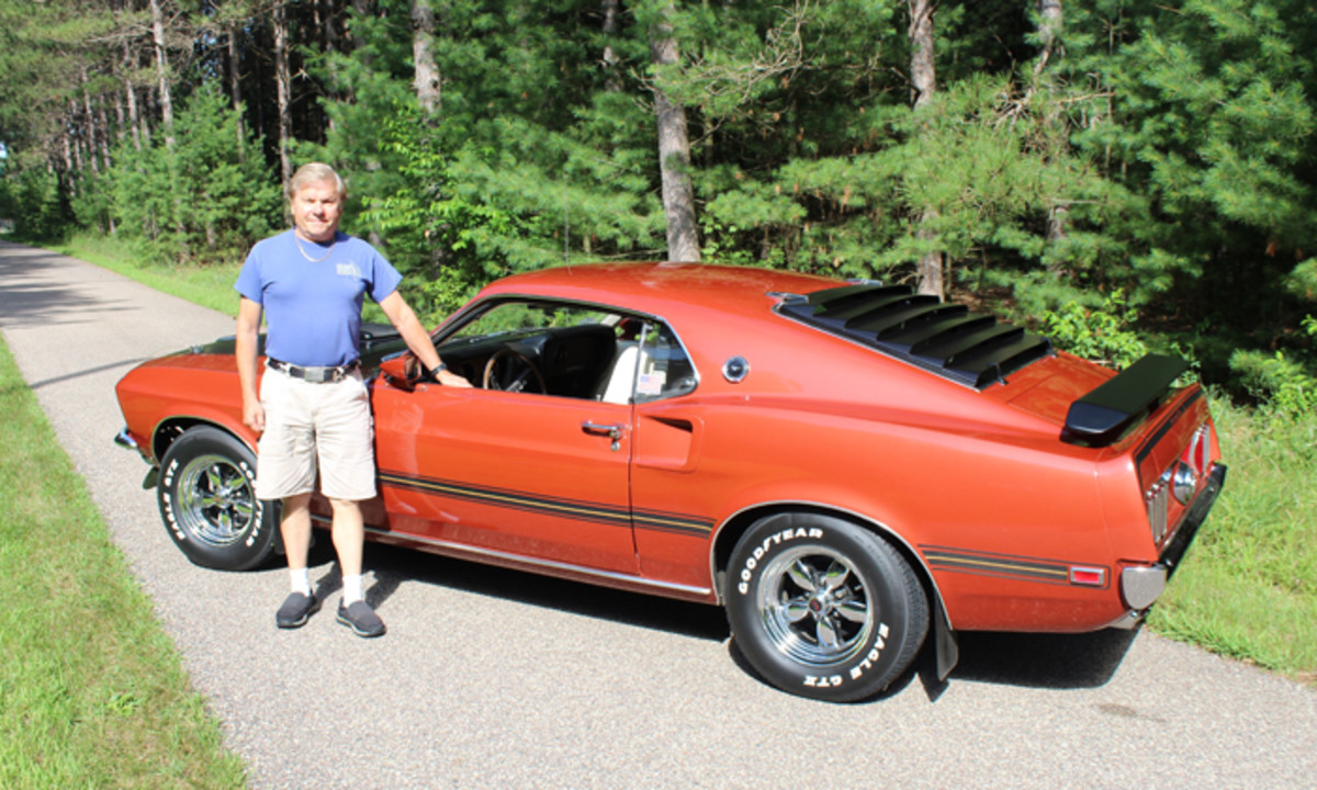 Tom Mangert with his gorgeous 1969 Ford Mustang Mach 1 that he has owned since he ordered it new in the summer of '69.