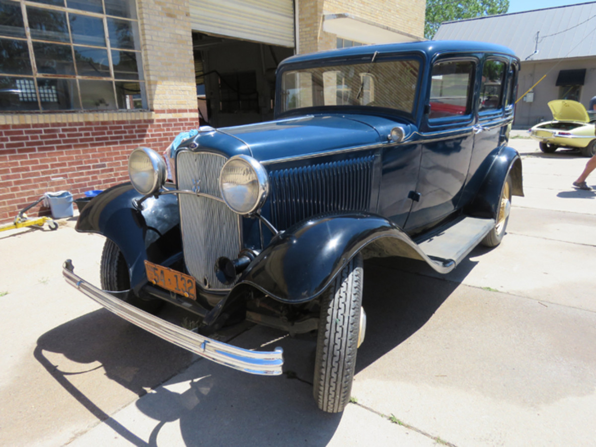 Blue 1932 Fordor is the nicer of two in the Regehr collection. This Deuce four-door has the less common 25-slot louver hood.