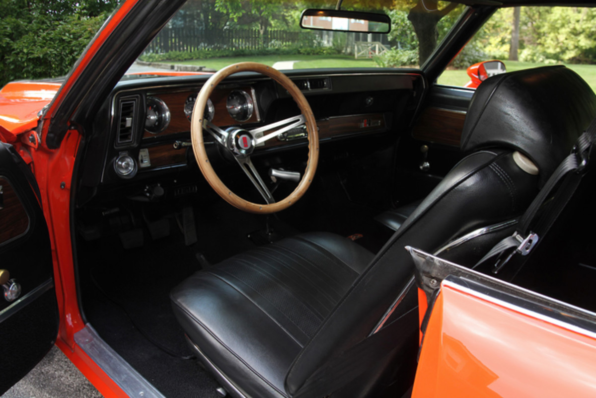 The Cutlass Supreme sports bucket seats and a four-speed manual transmission.
