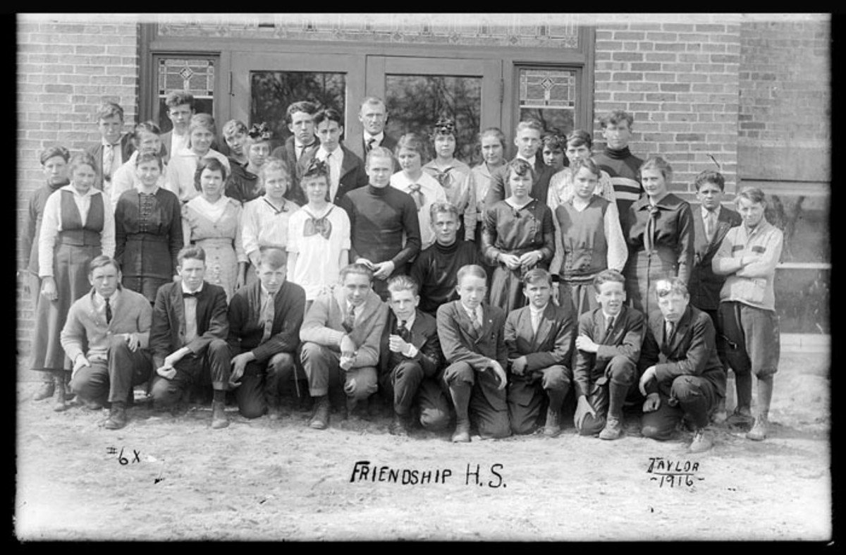 The graduating class of 1916 from Friendship Wisconsin High School. Harvey Church is the small boy on the far left, seen standing behind a girl.