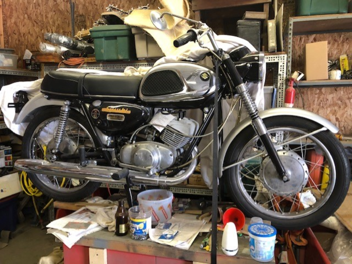 1965 Suzuki X6 Hustler, bought when in the service as a basket case, repaired on ship and rode back and forth to base. My son found it in a barn about 4 yrs. ago, and I restored it back to the way it was. It still has the military gate pass on front forks and Chip sticker on it.