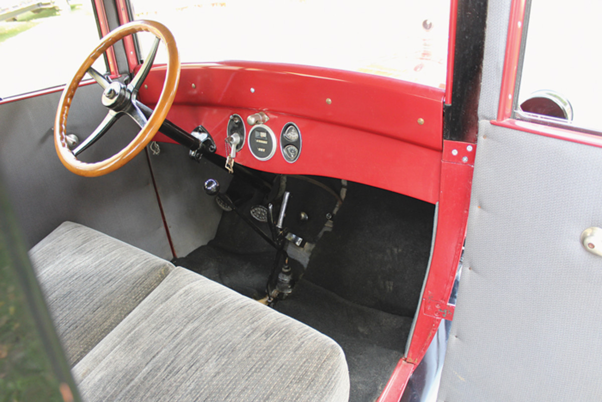The simple interior is a pleasant place to be, thanks to some nice upholstery work from a local woman. The do-it-yourself two-tone paint job still looks great, with the red color continued inside on the dash and frames. Under all that sheet metal is a re-made wood skeleton that Knuth, his father, son and friends painstakingly recreated.