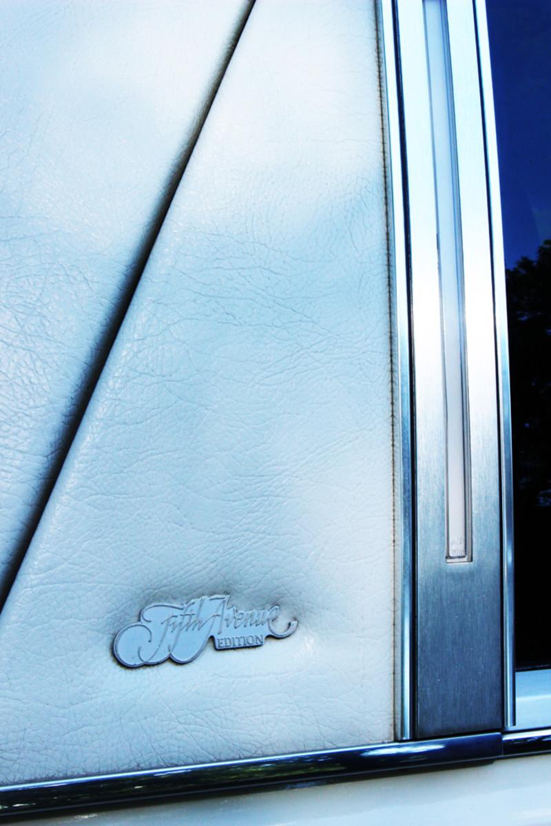Special Fifth Avenue Edition emblems adorn the vinyl-clad C pillars.