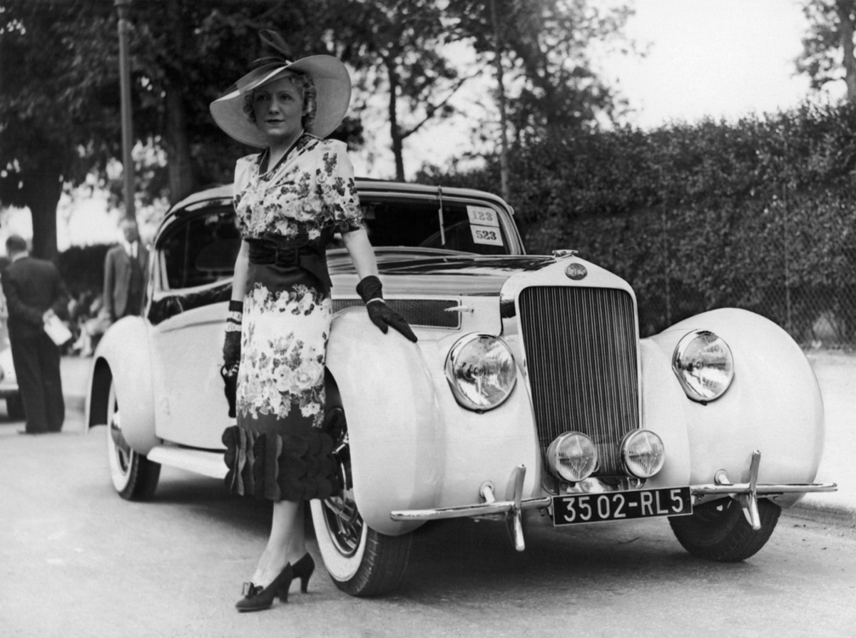 A stunning Delage that appears to have the fastback Aerosport coachwork by Letourneur et Marchand built on some D8 and D6 chassis. The unidentified woman with the Delage is pictured at the Bois De Boulogne concours on June 9, 1938.