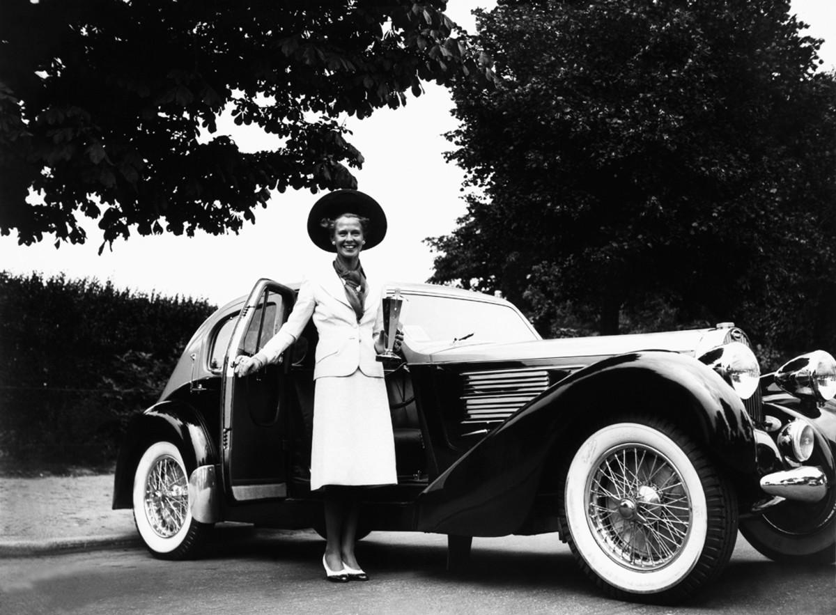 Countess Bernard D Oncieu De Chaifardon with her Type 57 Bugatti at Bois De Boulogne, France, during June 1939. The car wears Galibier coachwork, a name applied by Bugatti to its Type 57 sedans.