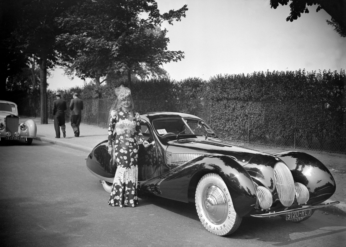 Miss Burney Nino wears garb almost as flamboyant as the Figoni et Falaschi-bodied Talbot-Lago T-150C SS teardrop coupe she's posed against at the Bois De Boulogne in Paris on June 9, 1939. Note the car's white tires, a very rare sight by the 1930s.