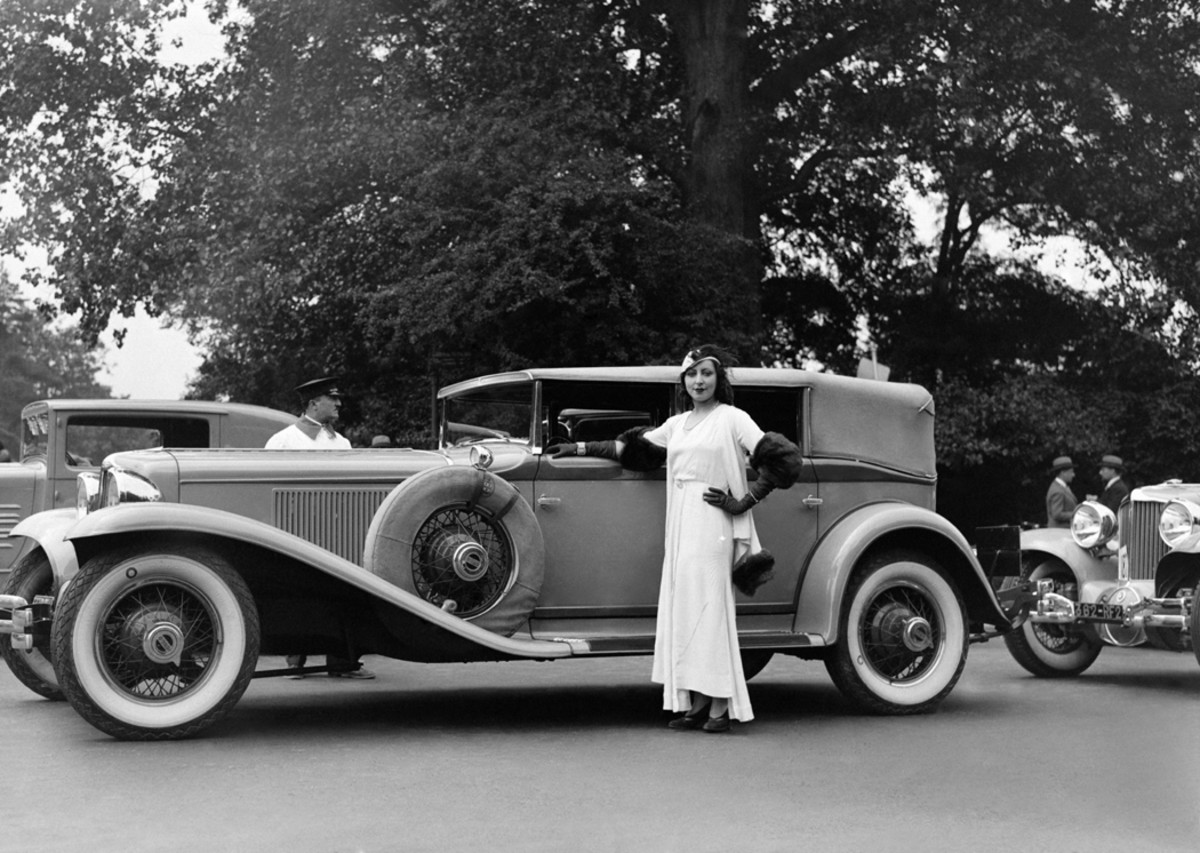 Not all concours participants were custom-bodied creations; this low-to-the-ground Front-Drive Cord with a standard body stood as proud as any car at the concours d'elegance at Bois de Boulogne in Paris, France, in 1931. Note the second Cord behind it.