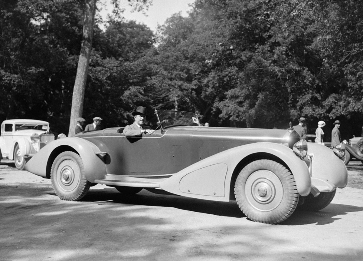 A companion to madame's Delage D8S coach (right) shown at the 1932 concours d'elegance at Fontainebleau, France, was monsieur's racier Delage D8-15 speedster. The location of the headlamps atop the fenders was unusual, as was the lack of a front bumper. This is believed to be the speedster built by Delage's own coachwork department.